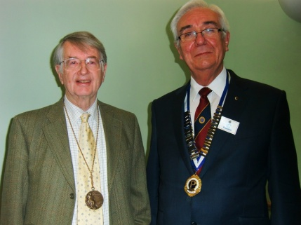 John Kynoch wearing his Olympic bronze medal with Probus President Paul Flint